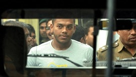 Former president Mahinda Rajapakse's second son Yoshitha Rajapakse being taken in handcuffs after he