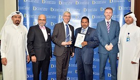 Seetharaman and senior Doha Bank officials receiving the awards.