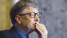 Microsoft co-founder Bill Gates listens during a financial inclusion forum at the US Treasury Depart