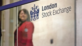 A visitor passes a sign inside the London Stock Exchange. The FTSE 100 closed up 0.7% at 6,137 point