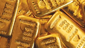 One hundred gram gold bars are seen in this arranged photograph at Gold Investments bullion dealers