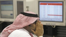 A Saudi trader monitors stocks at the Saudi Investment Bank in Riyadh (file). The Saudi stock index