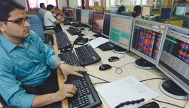 A trader monitors share prices on his terminal at a brokerage house in Mumbai. The Sensex gained 0.3