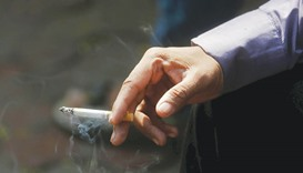 A man smokes a cigarette along a road in Mumbai, India. A parliamentary panel in India reviewing whe