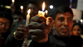 Students take part in a candlelight vigil for the Indian soldiers killed in a militant attack at Pat