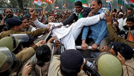 Demonstrators try to cross a police barricade during a protest - India