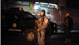 Afghan policemen standing guard at the site of an explosion near the governor's compound in Kandahar