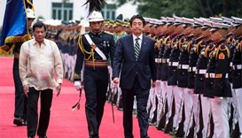 Abe visits Philippines as Duterte's first top guest