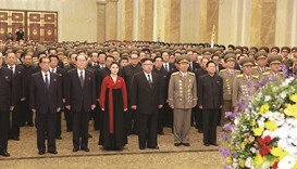 Kim Jong-un and wife Ri Sol-ju visit the Kumsusan Palace of the Sun on New Year's Day.
