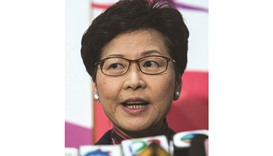 Carrie Lam speaks at a press conference to announce her resignation from the Legislative Council in