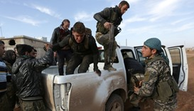 Free Syrian Army fighters help their fellow fighter near the northern Syrian town of al-Bab, Syria