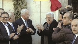 Palestinian President Mahmoud Abbas applauds after he inaugurated the new  Palestinian diplomatic m