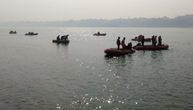 Indian rescue workers search for victims of a boat accident on the river Ganges near Patna