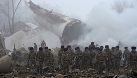 Rescue personnel work at the crash site of a Turkish cargo plane in the village of Dacha-Suu outside