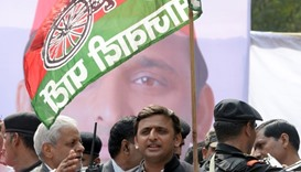 Akhilesh Yadav holding a flag bearing his Samajwadi Party symbol