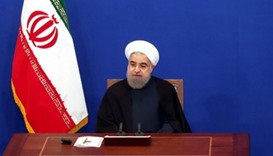 Iran's President Hassan Rouhani attends a news conference in Tehran