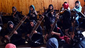 Afghan music students play during a rehearsal at The Afghanistan National Institute of Music in Kabu