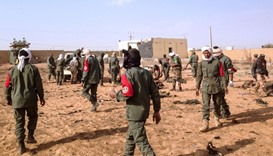 Soldiers attend to wounded and casualties in the aftermath of a suicide bomb attack- Mali