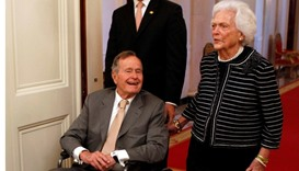 Former US President George H. W. Bush (L) and former first lady Barbara Bush