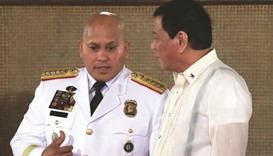 Philippine President Rodrigo Duterte (right) talks to Philippine National Police (PNP) chief Ronald