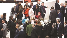 Ruling AK Party and opposition lawmakers scuffle after Turkish deputy Aylin Nazliaka (centre) handcu