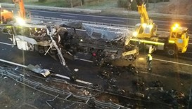 The burnt out wreckage of a bus on a motorway near Verona
