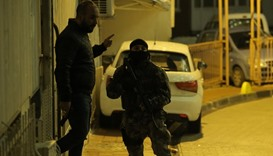 Members of police special forces take part in an operation near the police headquarters after an att