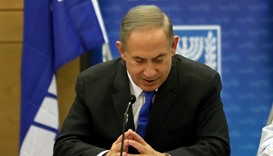 Israeli Prime Minister Benjamin Netanyahu gestures as he speaks during a Likud faction meeting