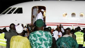 Former Gambian President Yahya Jammeh boards a plane at the airport as he flying into exile from Gam