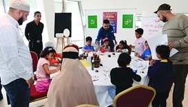 Children participate in an Arabic calligraphy workshop at the event