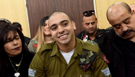Elor Azaria sits with his at the military court in Tel Aviv