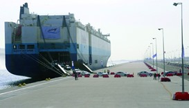 A ship unloads a number of vehicles at the Hamad Port (file). Overall, Qatar has been ranked 12th am