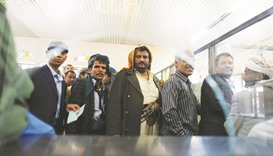 Public sector employees wait to receive their salaries at a post office in Sanaa, Yemen.