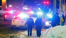 Police officers are seen near a mosque after a shooting in Quebec City.