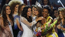 Contestants congratulate Miss France Iris Mittenaere after she won the 65th Miss Universe beauty pag