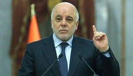 Iraqi Prime Minister Haidar al-Abadi (C) speaking during an official meeting in the capital Baghdad.