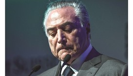 Brazilian President Michel Temer gestures during the Latin American Investment Conference in Sao Pau