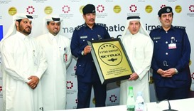 Al-Baker and al-Meer with senior officials following the bestowing of '5-Star Airport' designation