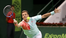 Czech Republic's Tomas Berdych returns the ball to France's Jo-Wilfried Tsonga
