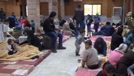 Civilians, who were evacuated from Wadi Barada, sitting inside a shelter in the Damascus suburb