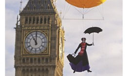 """An image depicting the film character """"Mary Poppins"""" wearing a pollution mask is floated in the air"""