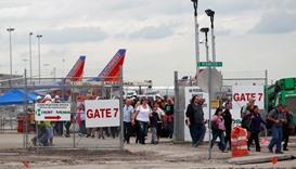 People exit the airport perimeter following a shooting incident at Fort Lauderdale-Hollywood Interna