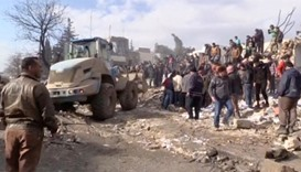 Bulldozer moving debris after a fuel truck exploded in the centre of rebel-held Azaz