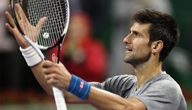 Serbia's Novak Djokovic reacts to winning against Britain's Andy Murray