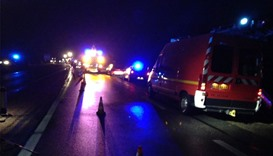 Rescue vehicles at the accident site in central France.