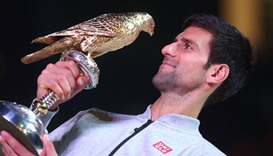 Serbia's Novak Djokovic poses with the winner's trophy