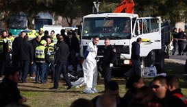 Israeli security forces and emergency personnel gather at the site of a vehicle-ramming attack in Je