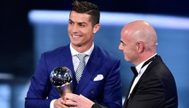 Real Madrid and Portugal's forward Cristiano Ronaldo (L) is presented with The Best FIFA Men's Playe