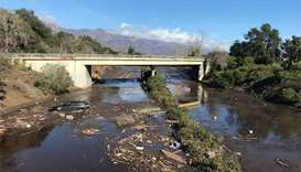 Rescuers search for victims as California mudslide toll hits 17