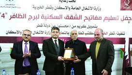 Qatar Charity officials and Palestinian authorities announce the completion of Al Dafer Tower recons